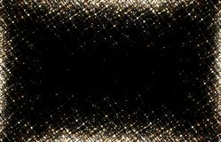 Gold glitter on black background isolated. Bright sequins. Sparkling festive background. Stock Photography