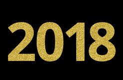 2018 of gold glitter on black background, symbol of New Year Stock Photo