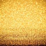 Gold glitter and bokeh background Royalty Free Stock Photos