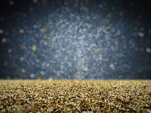 Gold glitter with bokeh background. Gold glitter with bokeh on black background stock image
