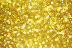 Gold glitter bokeh with stars background Stock Photos