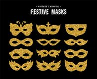 Gold glitter carnival mask set for party event. Gold carnival masks template set made of golden glitter dust. Luxury party costume isolated over white background Royalty Free Stock Photo