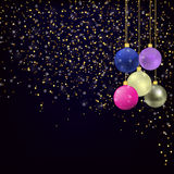 Gold glitter and Christmas balls on dark blue background. Stock Image
