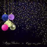 Gold glitter and Christmas balls on dark blue background. Stock Photography
