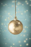 Gold Glitter Christmas Bauble on Turqoise with Stars Royalty Free Stock Photo