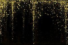 Gold glitter confetti texture on a black background. Golden explosion of confetti. Golden grainy dust abstract texture. On a black background. Christmas stock illustration