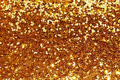 Gold glitter background, Golden Holiday Abstract Glitter Defocused Background With Blinking Stars. Christmas Background. stock photos