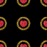 Gold glitter.Heart from red confetti.Heart pattern.Gold sparkles Royalty Free Stock Photos