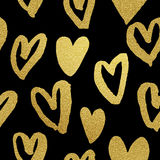Gold glitter hearts pattern Valentine day black background Stock Photo