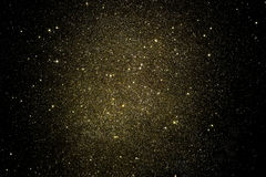 Free Gold Glitter On A Black Background Stock Photo - 76324530