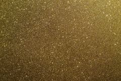 Gold glitter. Photograph of metallic, sparkly, shiny and shimmery gold glitter royalty free stock photography