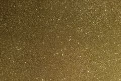 Gold glitter. Photograph of metallic, sparkly, shiny and shimmery gold glitter stock photo
