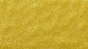 Gold glitter shining abstract background. rough textured golden glitter surface stock images