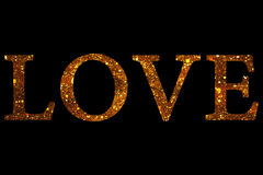 Gold glitter sparkle particles love word shape on black background, holiday festive valentine day love. Concept Stock Photo