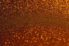 Gold Glitter Sparkles Background. Texture with Selective Focus royalty free stock images