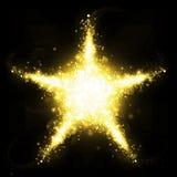 Gold glitter star of blinking stars Royalty Free Stock Photo