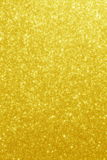Gold Glitter Stars Background. Golden Backdrop with stars in blurred lights royalty free stock photo
