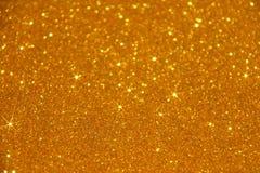 Gold Glitter Stars Sparkle Background - Stock Photo Stock Image