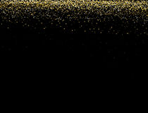 Gold glitter texture on a black background. Golden explosion of confetti. Golden abstract  texture on a black  background. Stock Photography