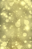 Gold glitter texture. Golden sparkling background. Vertical abstract yellow wallpaper with star dust and stars. Glittering design concept for party invitations Stock Image