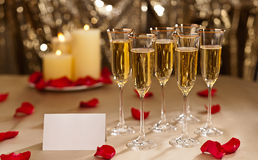 Gold glitter Wedding reception setting with champagne royalty free stock photography