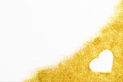 Gold glittering background of glitter and heart shape. Royalty Free Stock Image