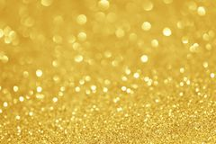 Gold glittering christmas lights. Blurred abstract background Stock Image