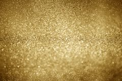 Gold glittering christmas lights. Blurred abstract background stock photos