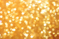 Gold glittering christmas lights. Blurred abstract background Royalty Free Stock Photo