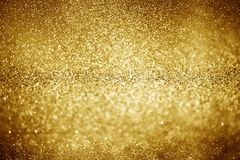 Gold glittering christmas lights. Blurred abstract background royalty free stock photography