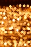 Gold glittering christmas lights bokeh. Blurred abstract background stock image