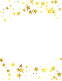 Gold glittering foil stars on white background Royalty Free Stock Photos