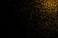 Gold glittering light bokeh abstract particles with christmas dark background.  stock illustration