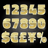 Gold glittering metal alphabet set numbers and symbols Royalty Free Stock Photography