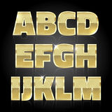 Gold glittering metal alphabet set A to M Stock Photo