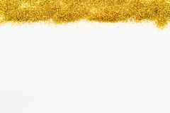 Gold Glittering sequins at the top of the background. Royalty Free Stock Photo