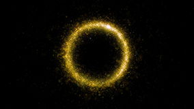 Gold glittering star dust circle of trail sparkling particles on black