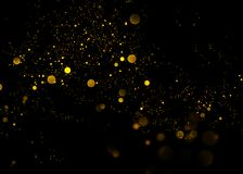 Gold glittering star light and bokeh.Magic dust abstract background element for your product. Gold glittering star light and bokeh.Magic dust abstract Stock Photos