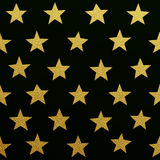 Gold glittering stars pattern Royalty Free Stock Photos
