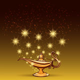 Gold glitters and aladdin lamp Stock Images