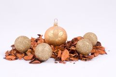 Gold glittery ornaments Stock Images
