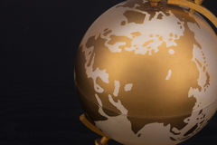 Gold globe. Of black background royalty free stock photography