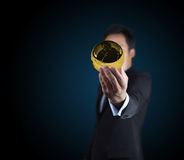 Gold globe on hands. Royalty Free Stock Photo