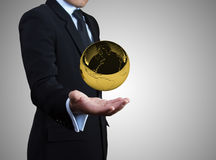 Gold globe on hands. Royalty Free Stock Image
