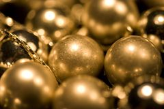 Gold glossy and matt balls. These are gold glossy and matt balls on chain Royalty Free Stock Image