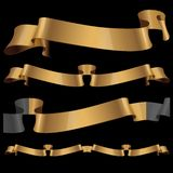 Gold glossy ribbons on a black background Stock Photo