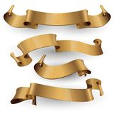 Gold glossy ribbons on a white background Stock Photo