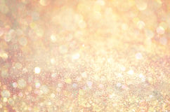 Gold Glow glitter background. Elegant abstract background with bokeh Stock Image