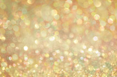 Gold Glow glitter background. Elegant abstract background with bokeh Royalty Free Stock Photo