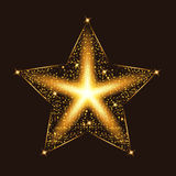 Gold glow glitter star with particles. Light effects. Royalty Free Stock Photo